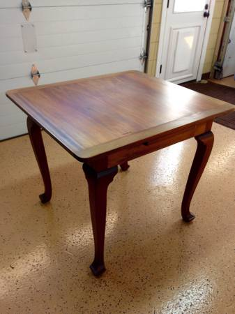Wood Table with Extensions     $125     View on Craigslist