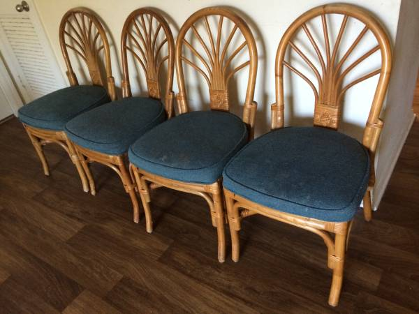 Set of 4 Rattan Chairs $25 These would look great with new seat cushions. View on Craigslist