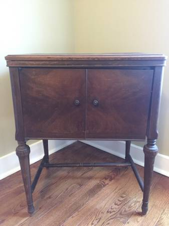 Antique Sewing Machine Cabinet     $40   This is a great little piece - would be a perfect end table or nightstand. I have a very similar sewing machine cabinet that we transformed into a vanity in our powder room.     View on Craigslist