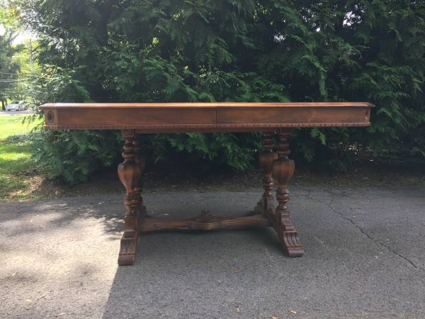 Antique Dining Table     $?   This antique table also has chairs and a matching buffet. Price is not listed but it is a beautiful set.    View on Craigslist