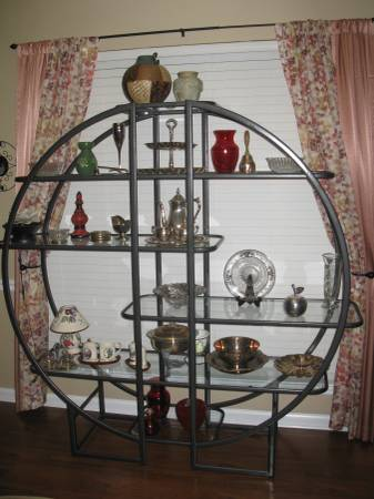 Circular Shelf $65 I think this would be pretty spray painted gold. View on Craigslist