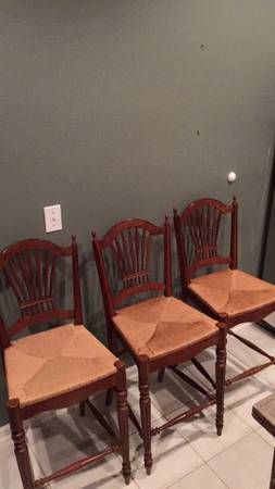 Set of 3 Bar Stools     $100   These chairs could be easily painted to match your kitchen.    View on Craigslist
