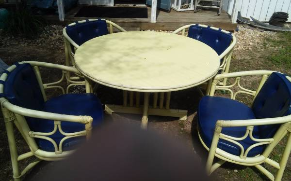 Rattan Patio Set $150 This could use a fresh coat of paint! View on Craigslist