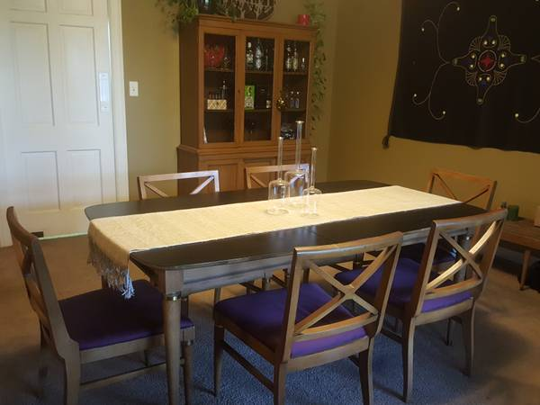 Mid-Century Dining Set $300 This set includes the table with six chairs and the china cabinet. I think the table and chairs would look great with new seat fabric - something with a bold pattern would look great. View on Craigslist