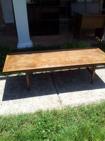 Coffee Table $10 This is a great project piece. It appears to be Mid-Century style based on the legs. It would be pretty refinished or with a coat of paint! View on Craigslist
