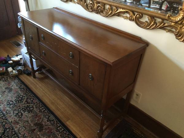 Vintage Buffet $100 Would look perfect with a coat of paint! View on Craigslist