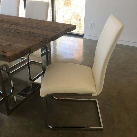 Set of 4 Leather Chairs     $200   Chairs are 4 for $100 or 2 for $100.    View on Craigslist