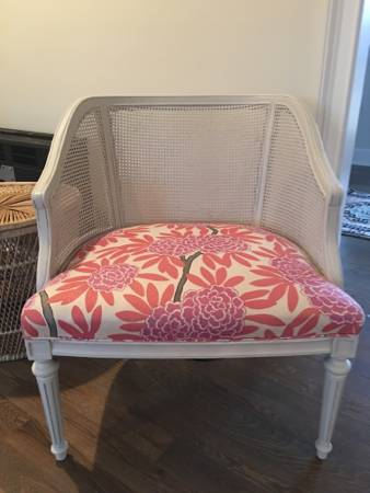 "Reupholstered Cane Chair     $200   This chair is upholstered in Caitlin Wilson design ""berry flour chinoise"" fabric.     View on Craigslist"