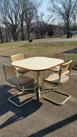 Table and Chairs $50 This is a great set but just needs a bit of work. I'd reupholster the seats and spray paint the meal legs.  View on Craigslist