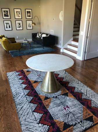 West Elm T     able        $500   Rug is also for sale.     View on Craigslist