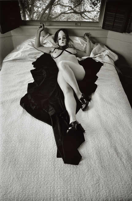 Untitled, (Nude with Mask on Bed) from the  Early Black and White Portfolio , circa Early 1970's Gelatin Silver Print  14 x 11 inches
