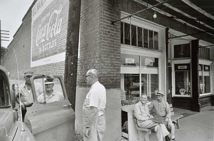 Untitled  (Man at store corner), 1960-1972 Gelatin Silver Print 16 x 20 inches
