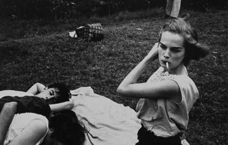Untitled  (Young woman smoking cigarette in Prospect Park)   from  Brooklyn Gang , 1959 Silver gelatin print 11 x 14 inches