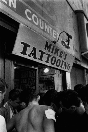 Untitled  (Mike's Tattooing)   from  Brooklyn Gang , 1959 Silver gelatin print 11 x 14 inches