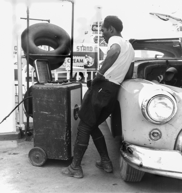 Dorothea Lange,  Man Working on His Tires, Oakland , 1952