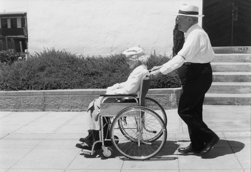 Dorothea Lange,  Man Pushing Woman in Wheelchair, Bay Area , 1950's