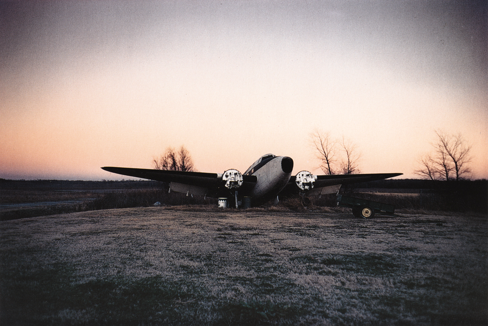 William Eggleston   Untitled  (Airplane in field), from  Southern Suite Portfolio , 1981
