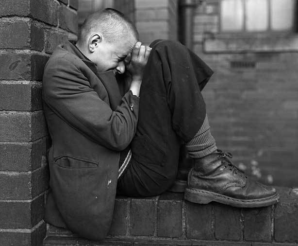 Chris Killip,  Youth on wall, Jarrow, Tyneside,  1976