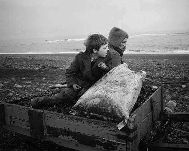 Chris Killip,  Rocker and Rosie going home, Seacoal Beach, Lynemouth, Northumbria,  1984