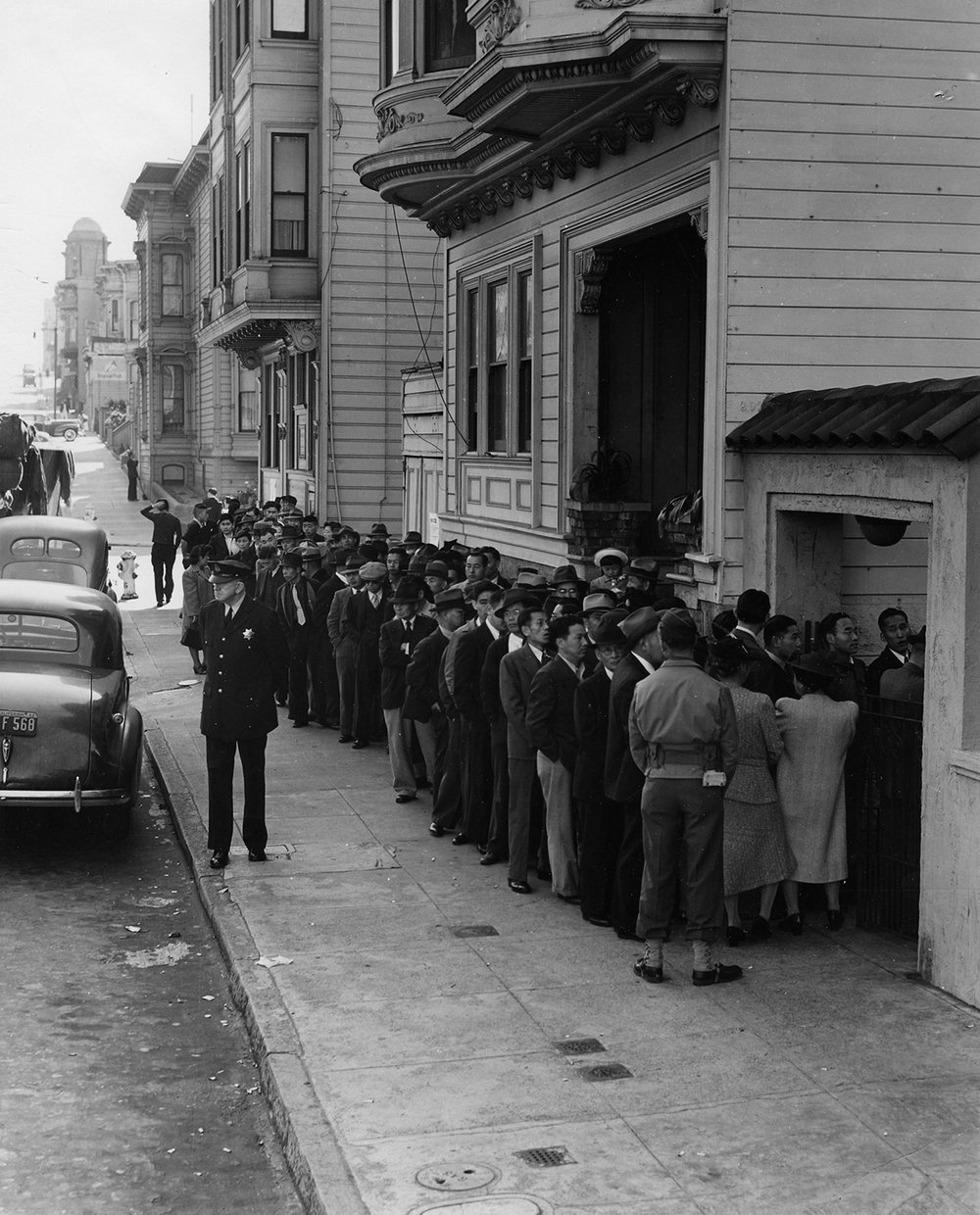 Dorothea Lange   Enforcement of Executive Order 9066, San Francisco, California,  1942  8 x 10 inches  Silver Gelatin Print
