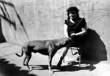 Graciela Iturbide   Doña Guadalupe y su perro , Juchitán, 1986 16 x 20 inch Silver Gelatin Print Signed, titled and dated by the artist in pencil on verso; signed by the artist in ink on recto Printed by the artist From the collection of the artist $6,000