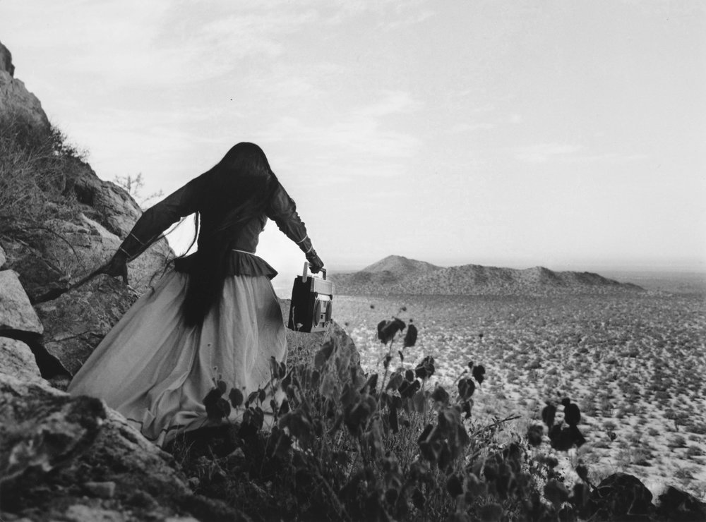 Graciela Iturbide   Mujer ángel, Sonora Desert , 1979 16 x 20 inch Silver Gelatin Print Signed by the artist on recto in ink Printed under the direct supervision of the artist From the collection of the artist Illustrated in: Graciela Iturbide, Images of the Spirit, Aperture, 1996, page 55 GCP28637 $8,000