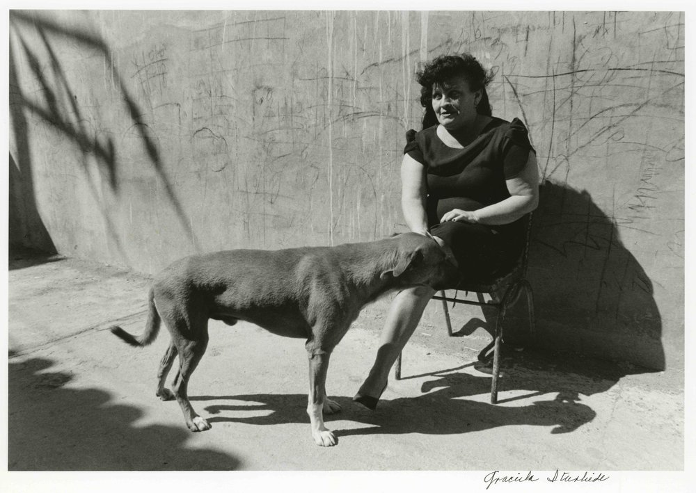 Graciela Iturbide   Doña Guadalupe y su perro , Juchitán, 1986 16 x 20 inches/Image 12.25 x 18 inches Silver Gelatin Print Signed, titled and dated by the artist in pencil on verso; signed by the artist in ink on recto Printed by the artist From the collection of the artist GCP17234 $6,000