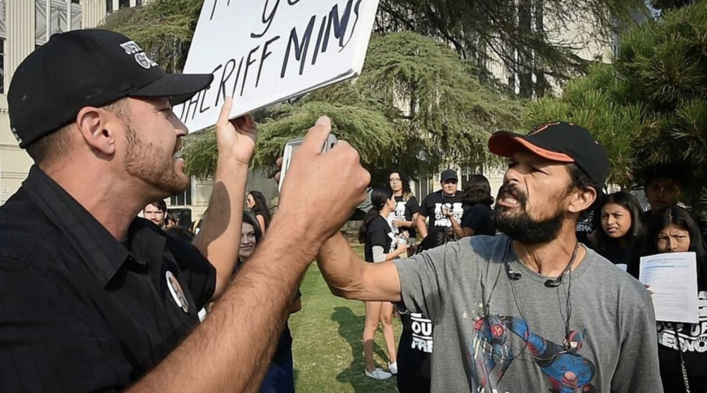 Pro-ICE supporter Ben Bergquam, left, and Jaimie Loza, right, who spoke out for immigrant rights, have a heated exchange at the community rally outside the Hall of Records building, Tuesday Aug 8, 2018. The demonstration was held to protest recent arrests by ICE agents at the Fresno County Courthouse.    JOHN WALKER    FRESNO BEE FILE