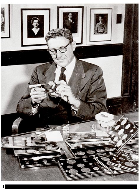 A Younger Louis Eliasberg Sr. examining his coin collection