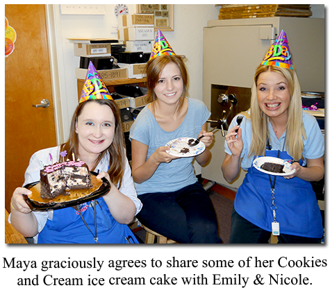 Cake-eating Southgate Coins employees Maya Jones and Nicole Hoff take a break from buying and selling rare coins and gold and silver bullion