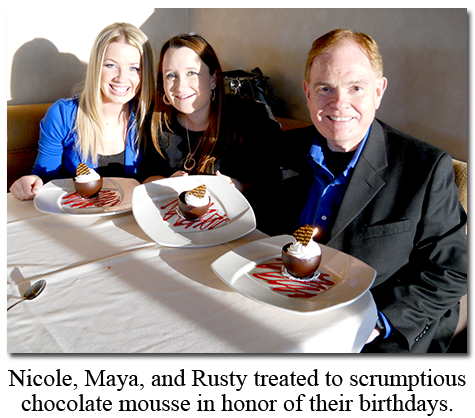 The three birthday people: Southgate Coins owner Rusty Goe, with Maya Jones and Nicole Hoff at Friday's Station