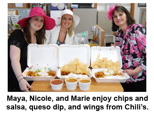 Southgate Coins employees enjoy food during the Kentucky Derby Day celebration