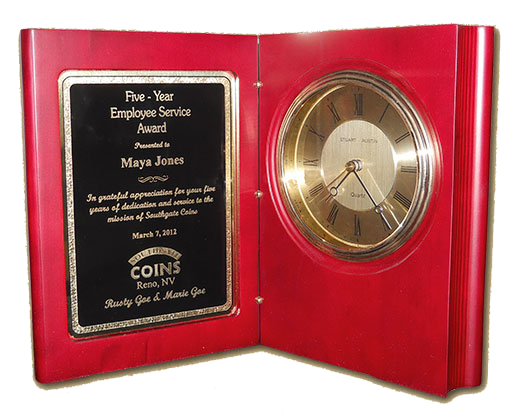 Southgate Coins owners Rusty and Marie Goe honor Maya Jones' annniversary with this special clock-plaque.