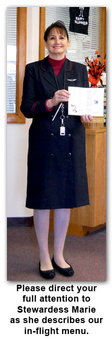 Southgate Coins owner Marie Goe dressed as a stewardess on Halloween 2011
