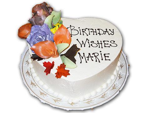 Marie Goe enjoys her Southgate Coins birthday cake