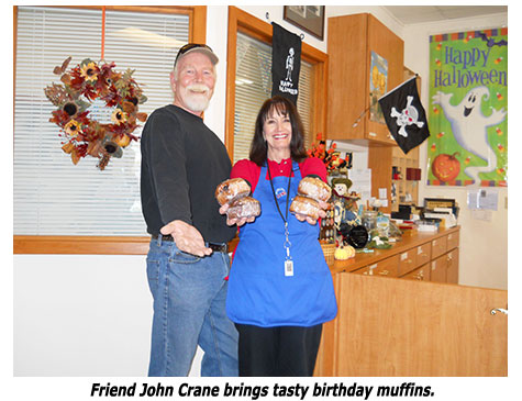 Southgate Coins client John brings owner Marie muffins on her birthday