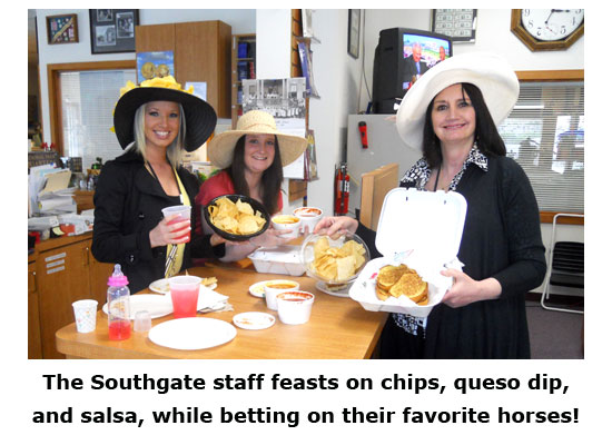 Southgate Coins poses with the feast, while preparing to watch the horserace