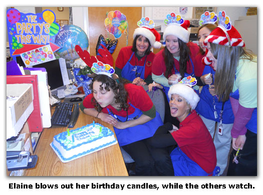 Southgate Coins employee Elaine blows out the candle in her birthday cake