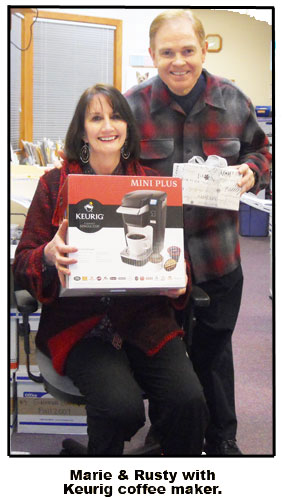 Southgate Coins employees, Nicole Hoff and Maya Roberts, gift store owners Rusty and Marie Goe a Keurig coffee maker