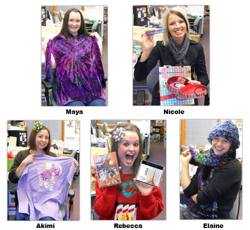 Southgate Coins employees display the gifts they received for Secret Santa