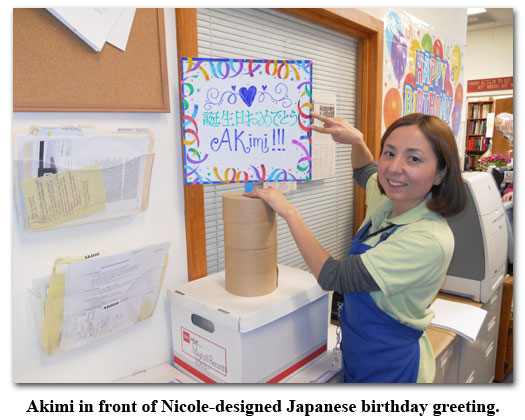 Nicole Hoff designs a Japanese-character birthday message for Akimi at Southgate Coins