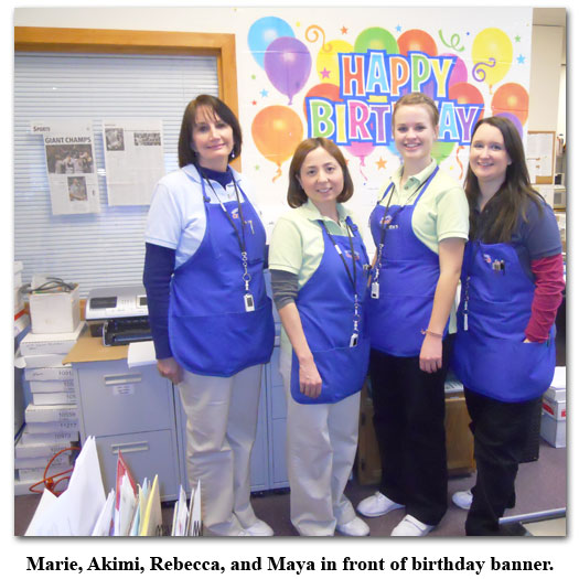 Southgate Coins owner, Marie Goe, poses with birthday girl Akimi and staff at the coin shop