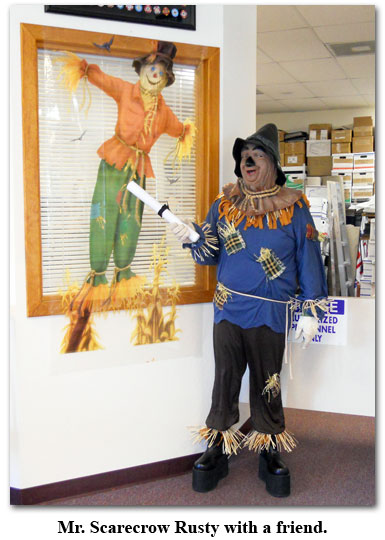 Southgate Coins owner, Rusty Goe, becomes the Scarecrow from The Wizard of Oz
