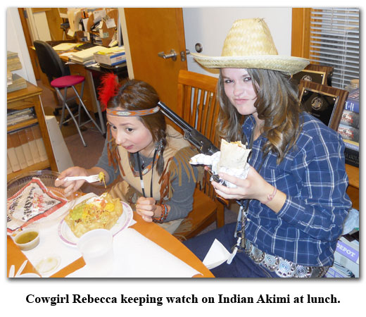 Rebecca and Akimi play 'Cowboys and Indians' at lunch on Halloween at Southgate Coins