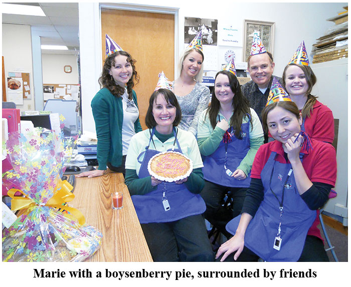 Birthday Girl Marie presents her boysenberry pie with Southgate Coins staff