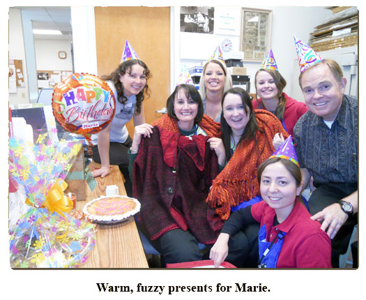 Marie gets warm, fuzzy gifts at her coin shop birthday celebration