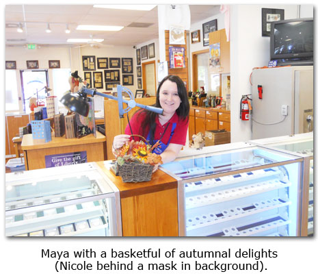 Southgate Coins employee Maya Roberts creats a fall basket for the coin shop