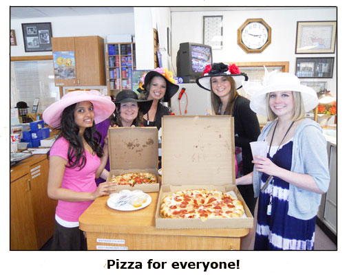 Coin shop employees enjoy pizza for lunch during Southgate Coins Kentucky Derby Day celebration