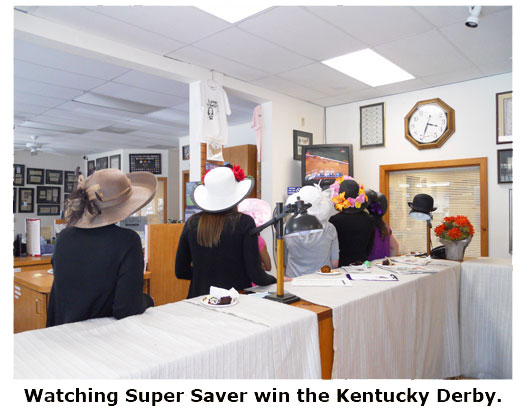Coin shop attendants watch Super Saver with the Kentucky Derby at Southgate Coins
