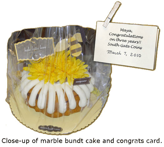 Maya Roberts is given a marble bundt cake for her 3-year anniversary at Southgate Coins
